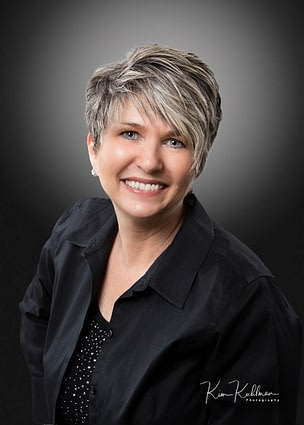 Professional headshot of woman small business owner demonstrating retouching